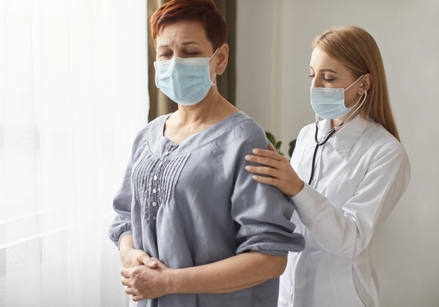 elder-patient-with-medical-mask-and-covid-recovery-center-female-doctor-with-stethoscope_23-2148847864